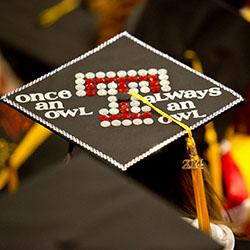 A graduation cap that says 'Once an owl, always an owl.'