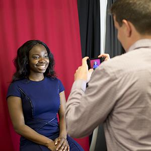 A woman has her photo taken.