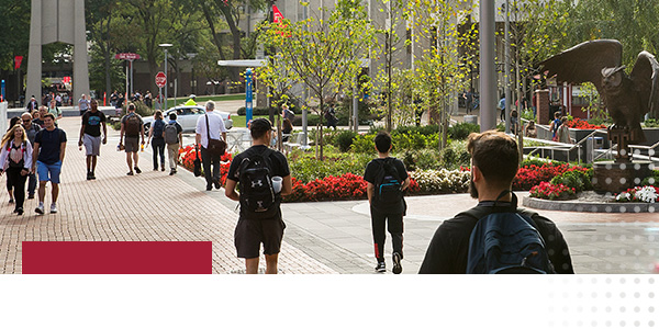 A photo of students walking on Temple University's campus.