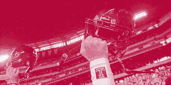 A red photo of Temple football players raising their fists.