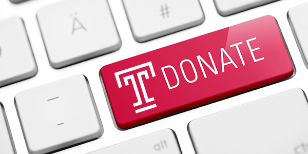 "Illustration of a computer key reading ""Donate,"" with a Temple T."