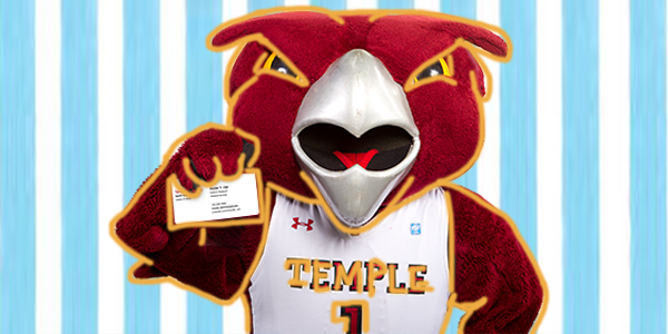 Temple mascot, Hooter, holding a business card.