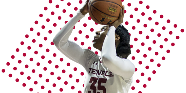 An image of a Temple women's basketball player shooting a ball.