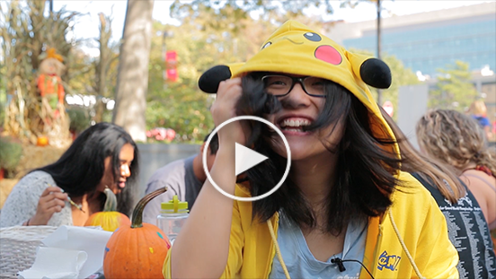 A STILL FROM THE VIDEO SHOWING A STUDENT IN A PIKACHU HOODIE