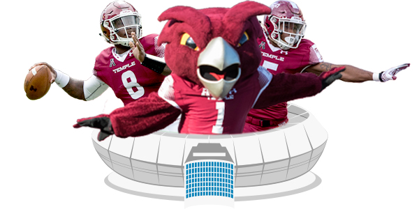 Two Temple football players and mascot Hooter emerging from a football stadium.