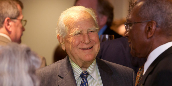 Lew Klein smiling and mingling at an event.