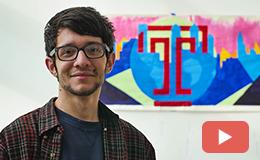 Juan Hurtado Salazar standing in front of a painting.