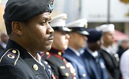 Military veterans standing in uniform.
