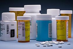 Several pill bottles and pills.