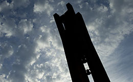 A shadowed Bell Tower during sunset.
