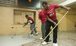 Temple students working together to clean a church.