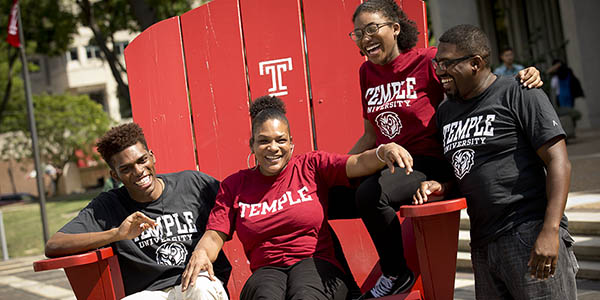 A family sitting together on a TU Big Chair.