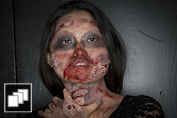 A female student in zombie makeup.