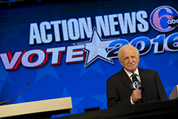A screen displaying Action News 6abc Vote 2016 and a male debate moderator.