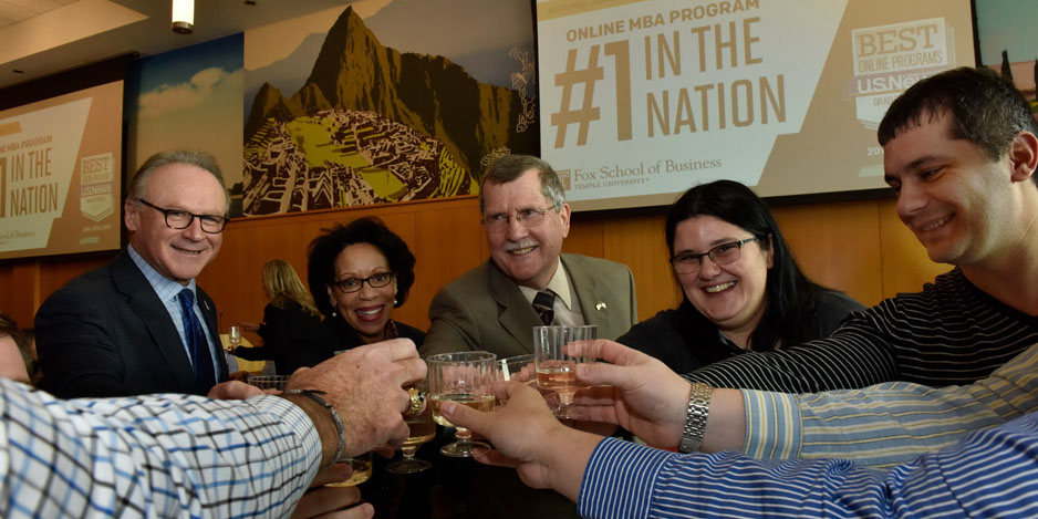 Richard Englert, JoAnne Epps and others toasting champagne in celebration.
