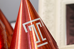 "A party hat with a Temple ""T""."