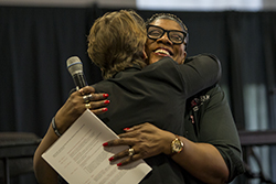 Laura Reddick hugging a woman.