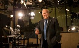 Lew Klein standing in a TV studio