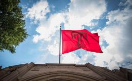 a Temple flag flying above Sullivan Hall