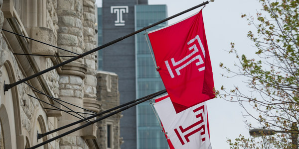 Temple flags with Morgan Hall in the background