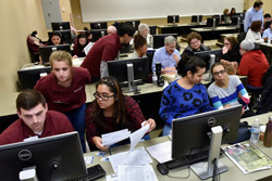 Temple students at computers helping residents file their taxes.