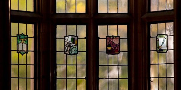 Images in stained glass windows on Temple's campus.