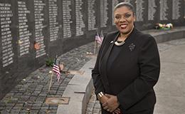 Laura Reddick standing next to the Vietnam Veterans Memorial in Philadelphia.
