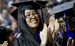 A woman wearing a cap and gown at last year's Commencement ceremony.
