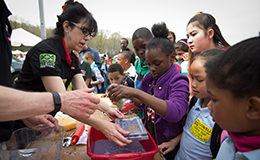 Children participating in a science experiment at last year's EarthFest.
