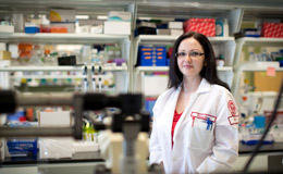 Polina Gross standing in a lab