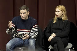 Zosia Mamet and Evan Jonigkeit sitting on stage talking to an audience of students.