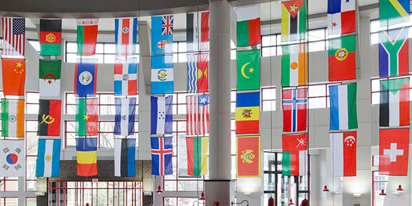 Several international flags hanging in the student center's atrium.