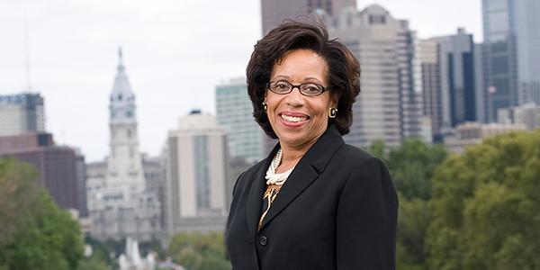 JoAnne A. Epps smiling with Philadelphia City Hall in the background.