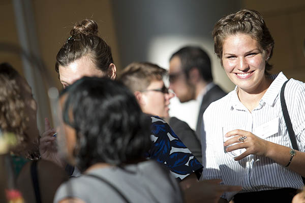 The Washington Center interns smiling and laughing at the reception.