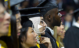 The students wearing academic regalia at the Commencement ceremony.
