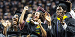 Temple graduates cheering at commencement.