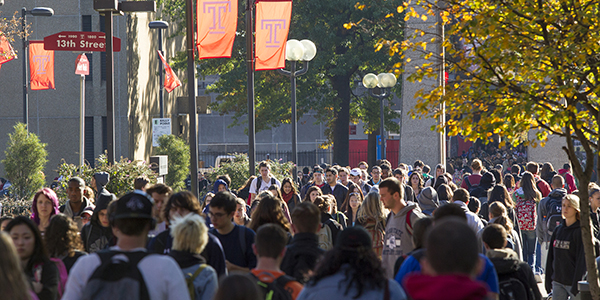 Temple students walking on campus.