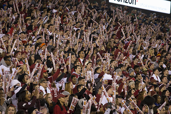 A cherry and white clad crowd cheers on the Temple football team at Lincoln Financial Field.