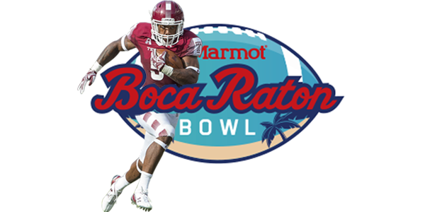 A Temple football player charging into the logo for the Boca Raton Bowl.