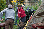 Temple volunteers working in a community garden on Global Day of Service.