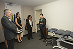 Temple President Neil D. Theobald tours the clinic with physical therapy students.