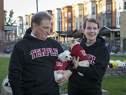 Gene and Cathy Salkind pose in Philadelphia with two small dogs.
