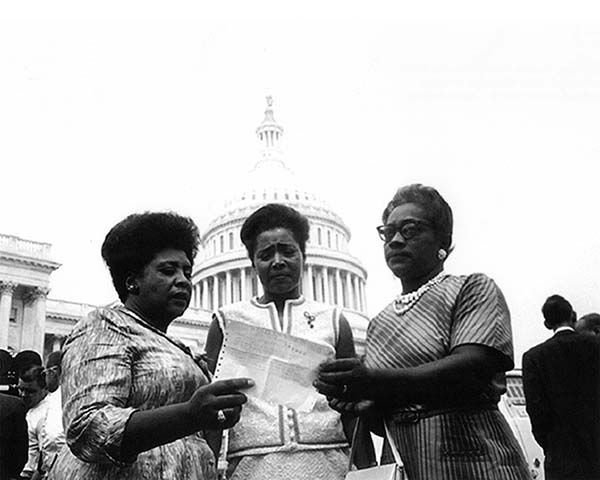 African American women civil rights leaders in front of the U.S. Capitol.