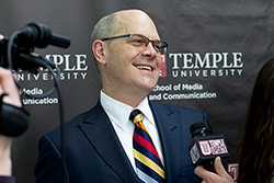 Steve Charles smiling while being interviewed on-camera by Temple Update.
