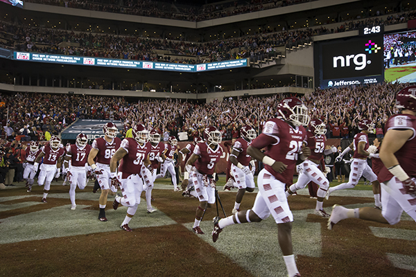 The Temple football team running onto the field at Lincoln Financial Field.