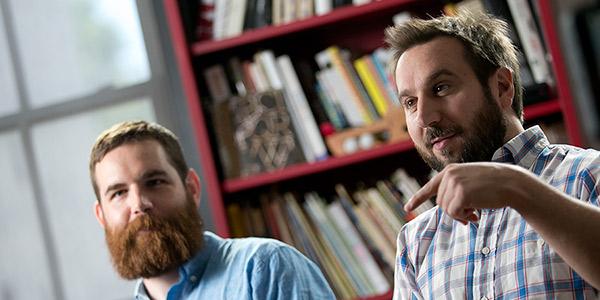 Two male Temple alumni their graphic design studio.
