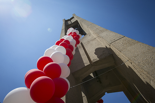 Cherry and white balloons decorating the bell tower.