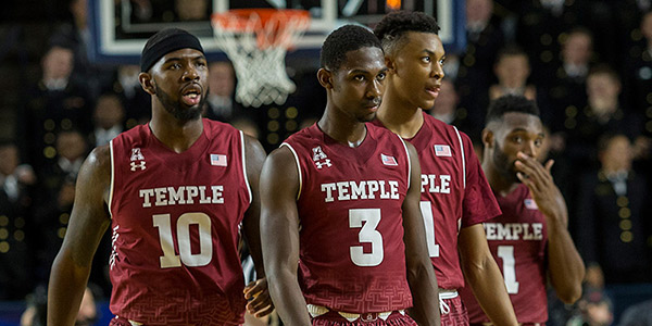 The Temple men's basketball team in their cherry uniforms.
