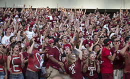 Owls fans wearing Cherry and White