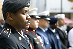 Uniformed service members attending a Temple Veterans Day ceremony.